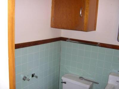 Bathroom Tile Remodel Blue Cabinet