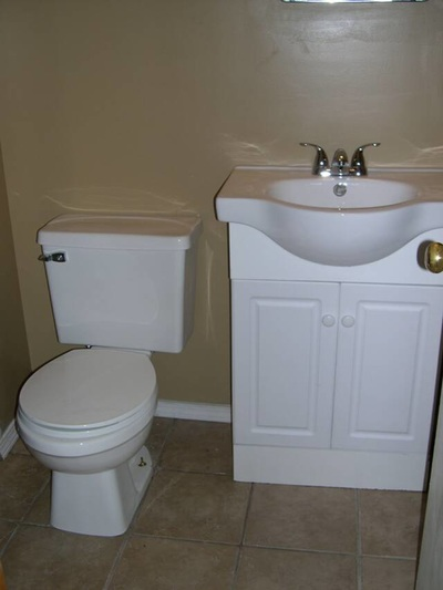 Bathroom Toilet and Sink White